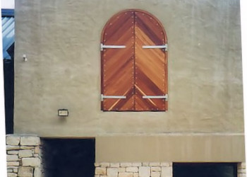 Arched diagonal slatted barn doors
